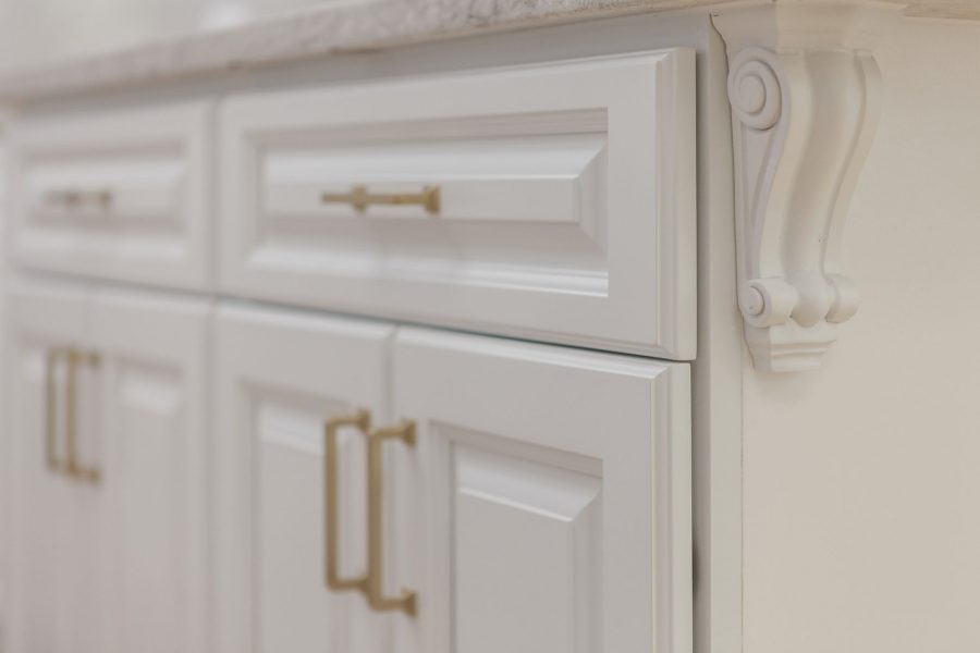 White Shaker Cabinets with Golden Pulls