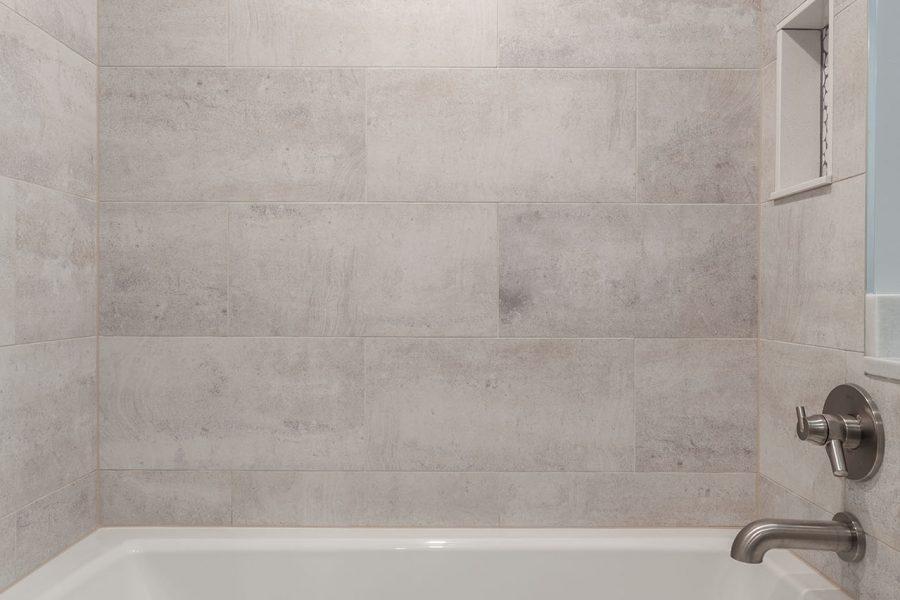 Drop-in Kohler Bathtub with Delta Faucet