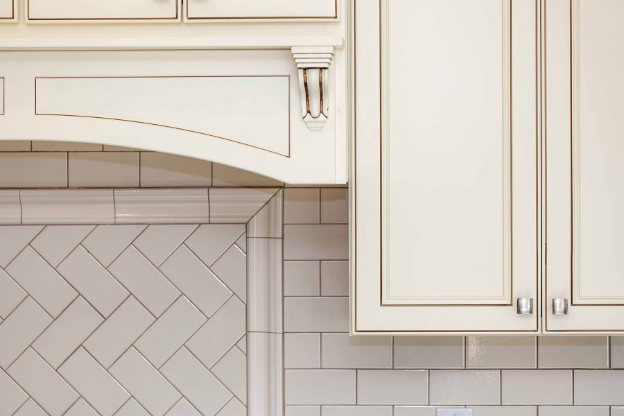 Classic subway pattern backsplash tile with grout color that matches the cabinetry's glazing for a nice blend
