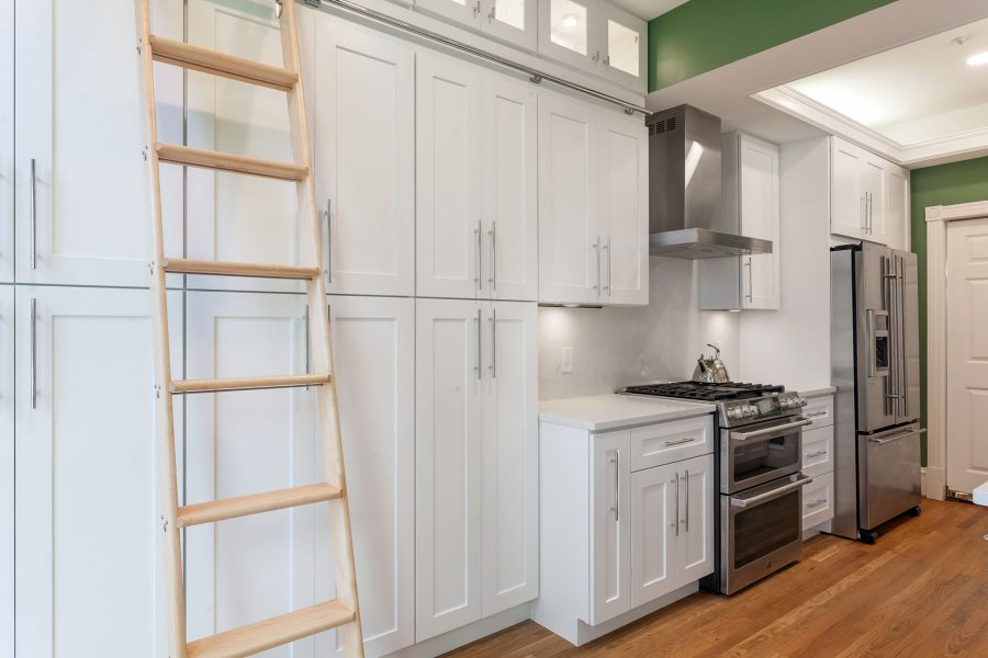 Built-in Pantry with Clear Glass Door Wall Cabinets on Top