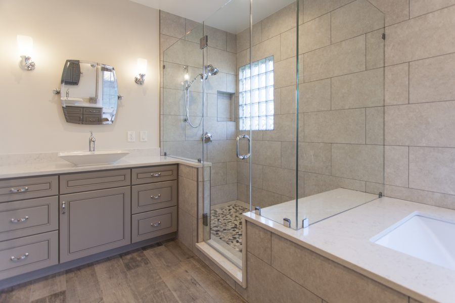 Wide shower with pebble floors and seating