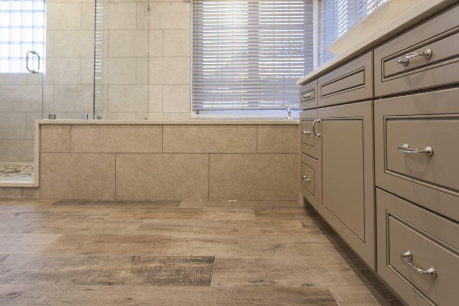 wood looking floor tiles and earthy tone wall tiles