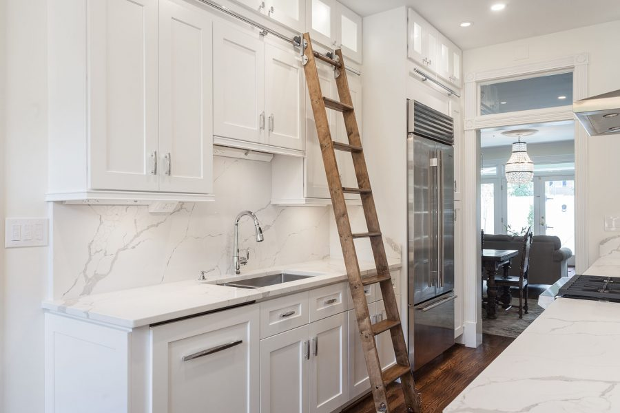 White Kitchen Cabinets with a Rolling Library Ladder