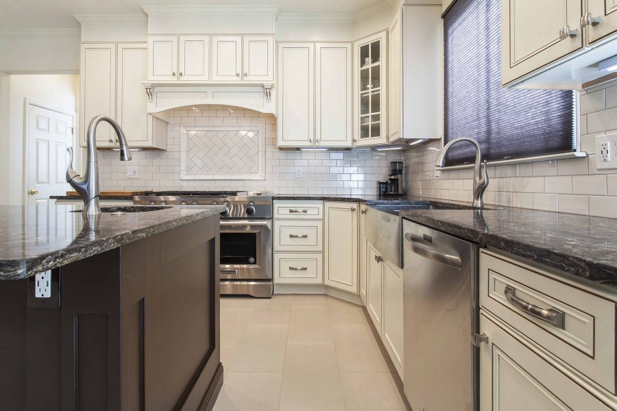 Ivory color kitchen cabinets and a glass front wall corner